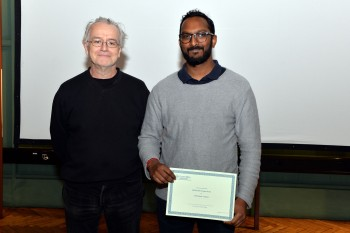 Caumaghen Sannassy (left) being congratulated on his award by Dr Adrian Briggs