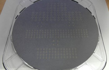 8-inch diameter graphene wafer with device test structures visible on the surface