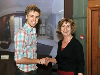 Oliver Angell being presented with his prize by Dr. Julia Shelton