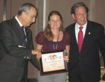 Dr Chavaunne Thorpe being presented with her certificate and cheque by Professor Giuliano Cerulli (L) and Professor Savio L-Y Woo (R).