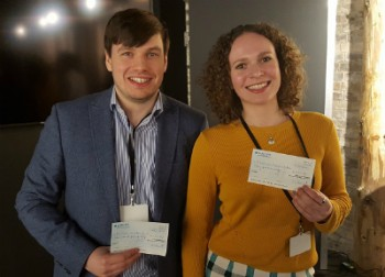 Richard and Kseniya holding their 1st and 2nd prizes, respectively