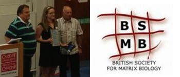 Clare collecting her award at the BSMB meeting from prof Vic Duance (right)