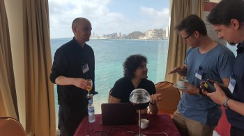 Hugh (left) and Michele (2nd left) are busy explaining their prototype device to conference delegates.