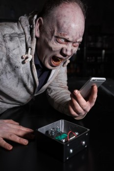 A zombie charging his phone using the energy harvesting technology. [David Parry/PA Wire]