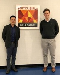 Chang (left) being welcomed to Birla by Lewis (right) on his first day.