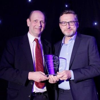 Andy Bushby receiving the Award from Graeme Browne, Director of Queen Mary Innovation.