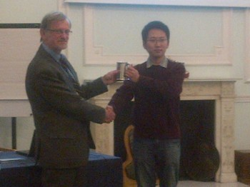 Congwei receives his award of the tankard bearing his name