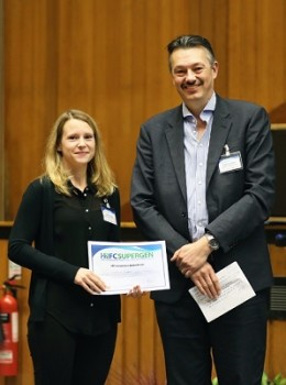 Kathrin is pictured receiving the award from Prof. Nigel Brandon of Imperial College